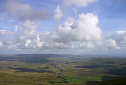 cumulus clouds in blue sky, seen from Whernside summit